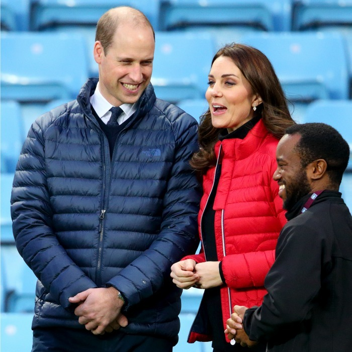 The royal pair, both 35-years-old, visited Aston Villa Football Club to check out the work of the Coach Core program on November 22, 2017 in Birmingham, England. William and Kate were all bundled up in matching down puffer jackets, the Prince's was blue while the Duchess opted for a bright red color.