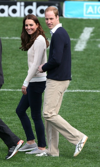 Sweaters and sneakers! The Prince and Princess coordinated with each other in cozy sweaters, slacks and sneaks, blending together in khaki colors as they attended a Rippa Rugby tournament. The visit was at Forsyth Barr Stadium on April 13, 2014 in Dunedin, New Zealand. The Duke and Duchess of Cambridge were on a three-week tour of Australia and New Zealand, which marked the first official trip overseas with their son, Prince George of Cambridge. 