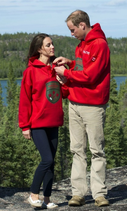 Prince William tenderly adjusted his wife Kate's Canadian Rangers sweater (which was the exact same as his) after the pair were named honorary members on July 5, 2011 in Blatchford Lake, Northwest Territories, Canada. The then-newly married royal couple were on the sixth day of their first joint overseas tour. The 12-day visit to North America consisted of some of the more remote areas of the country such as Prince Edward Island, Yellowknife and Calgary. 