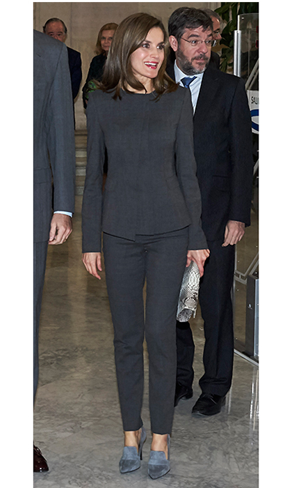Spain's Queen Letizia opted for a BOSS by Hugo Boss suit for a meeting at the National Library in Madrid on November 24. The royal completed the businesslike look with a reptile motif bag by Magrit and high-heeled grey suede loafers. 