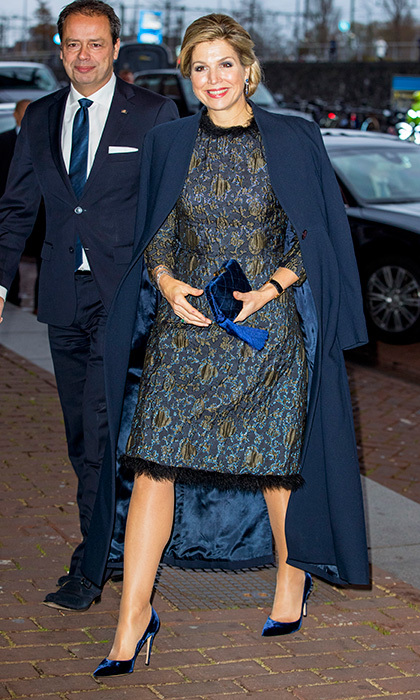 Queen Maxima of the Netherlands never fails to add a fun twist to her outfits. Here, she's wearing a brocade dress trimmed with feathers accessorized with royal blue velvet shoes and clutch for a playful mix of textures. The Dutch royal made the style statement at the Prince Bernhard Culture Foundation Awards in Amsterdam on November 27. 