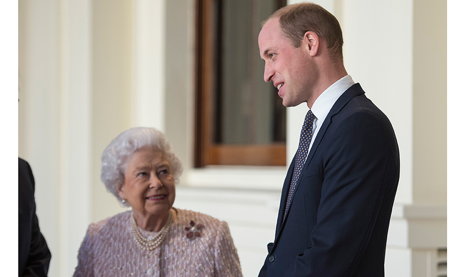 There's nothing like a grandmother's love! Queen Elizabeth proudly looked up at son Prince William during a meeting with the President of Germany Frank-Walter Steinmeier and his wife Elke Budenbender before a private lunch at Buckingham Palace on November 28. 