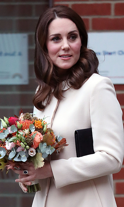 Currently expecting her third child, a rosy-cheeked Kate Middleton stepped out to visit the Hornsey Road Children's Centre on November 14. The British royal, who is a fan of the Urban Decay 'Naked' palette, wore a daytime smoky eye with her signature dark eyeliner.