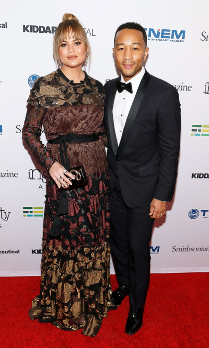 Chrissy Teigen showed off her new bangs and growing baby bump next to her dapper husband at the Smithsonian Magazine's 2017 American Ingenuity Awards in Washington, D.C. John Legend opted for a classic tuxedo for the evening in the nation's capital.