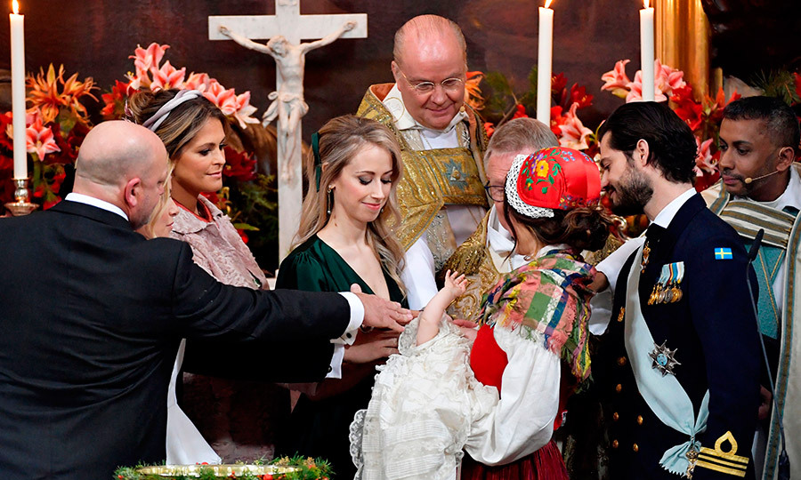 Princess Sofia's sister Sara Hellqvist, center, had a prominent role as godmother. Here she is at the altar with godfather Thomas de Toledo Sommerlath, godmother Princess Madeleine, Bishop Johan Dalman, Archbishop Anders Wejryd and Gabriel's parents Sofia and Carl Philip. 