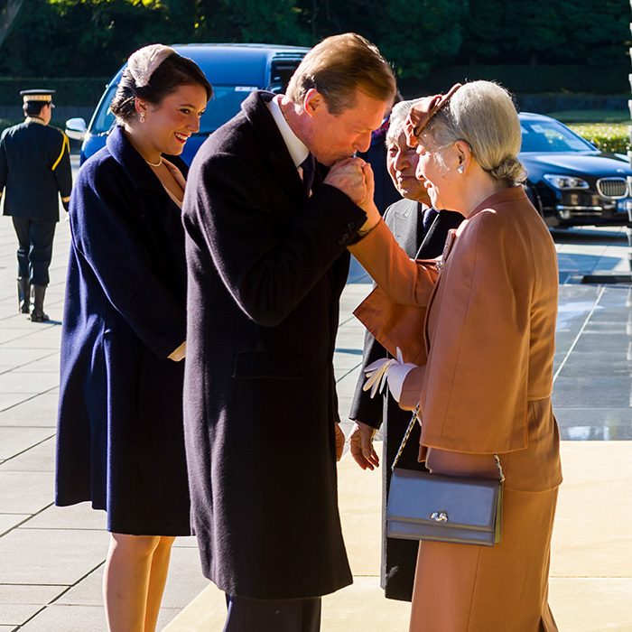 Princess Alexandra of Luxembourg looked on as her father Grand Duke Henri kissed the hand of Empress Michiko, who was joined by her husband Emperor Akihito. 