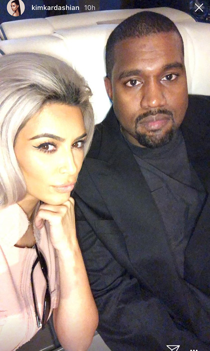Kim Kardashian and Kanye West were among the guests who checked into Chrissy's birthday at an airline terminal. For the occasion, the KKW Beauty founder wore her hair in a '60s-inspired look and outfit.