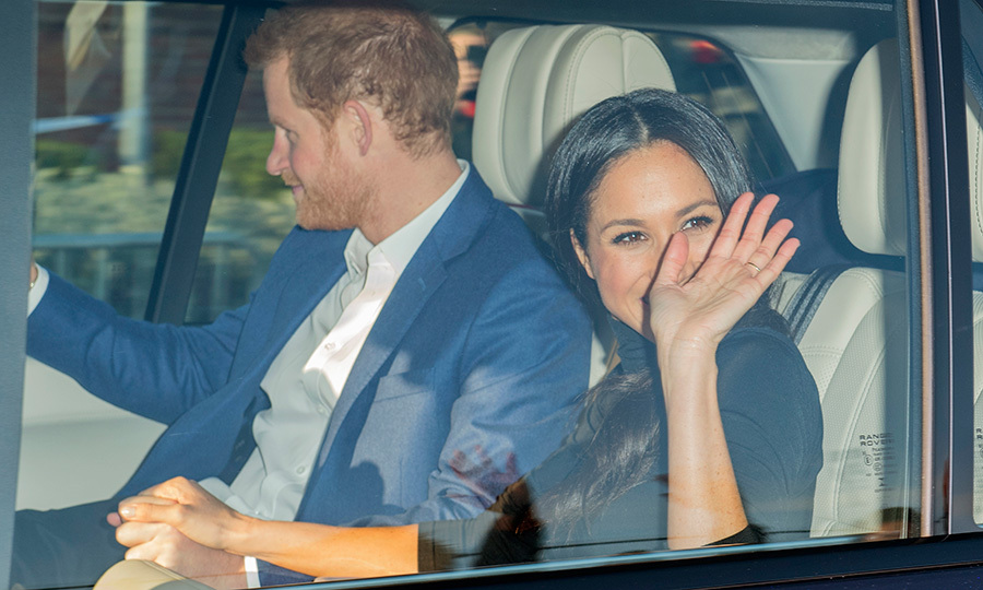 Even in the car after their first royal engagement together, Harry and Meghan still stayed close! As the future royal bride practiced her royal wave with one hand, her other was steadily placed on top of Harry's as the pair returned to their home at Kensington Palace.