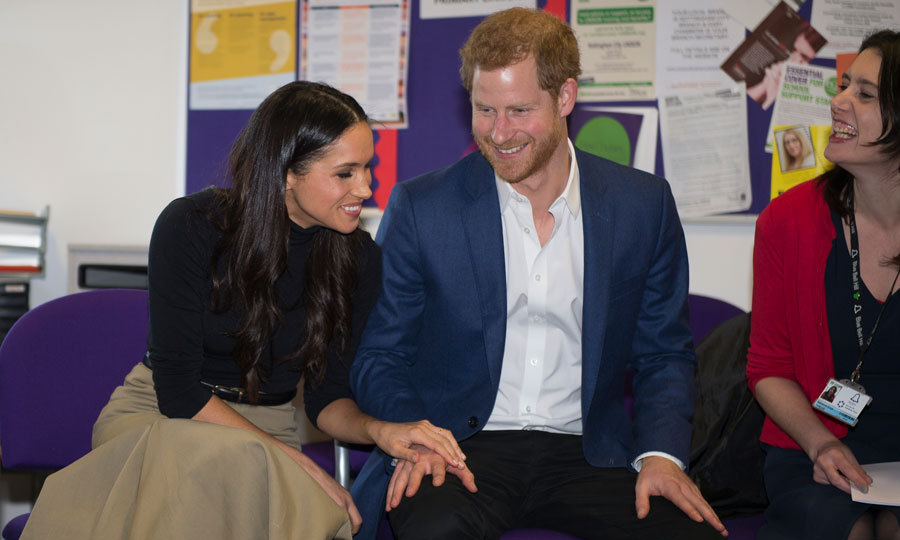 Harry and Meghan had lots of laughs with volunteers and mentors – and each other! – during their visit to Nottingham Academy. At the Friday Night Youth Club, Meghan placed her hand on top of Harry's as they chatted with students who participate in various activities funded by the organization.
