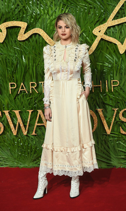 "Selena Gomez opted for a monotone look from head-to-toe for the 2017 Fashion Awards in partnership with Swarovski. The <i>Wolves</i> singer wore a custom prairie-style Coach dress and styled her hair with an extreme part and waves. She told Vogue UK, ""I haven't been in the space of doing the expected lately.""
