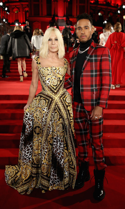 Donatella Versace was accompanied by racecar superstar Lewis Hamilton, who gave everyone major holiday-inspiration, to the 2017 Fashion Awards.