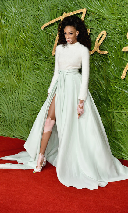 Winnie Harlow wore a white sweater with a mint green skirt by Brandon Maxwell to the 2017 Fashion Awards. The supermodel paired the look with pumps from Christian Louboutin. 