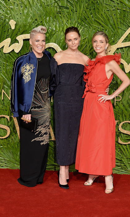 Pink was all smiles as she joined designer Stella McCartney and actress Annabelle Wallis on the carpet of the Fashion Awards in partnership with Swarovski. The singer added a navy bomber jacket to her gown while the other ladies bared their arms.