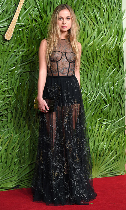 Once named the 'Most Beautiful Royal' by <I>Tatler</I>, Lady Amelia Windsor stole the show in a sheer dress by Christian Dior to the 2017 Fashion Awards in partnership with Swarovski, held at London's Royal Albert Hall. Prince William and Harry's cousin accessorized the edgy style with a mirrored clutch but kept her jewelry simple. 