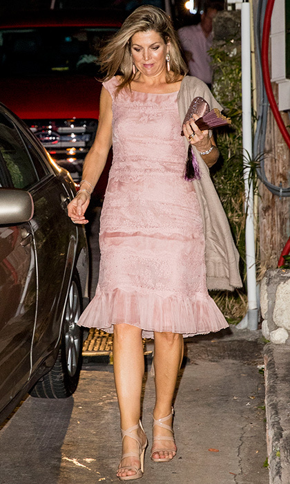 Queen Maxima stepped out in strappy nude sandals and a powder pink dress with pleated hem while visiting Saba. The Dutch royal was on her way to dinner with husband King Willem-Alexander. 