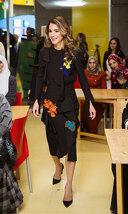 On December 4, Queen Rania made a fun and sophisticated style statement at the launch of 'Karim and Jana', a free mobile application developed by the Queen Rania Foundation for Education and Development (QRF) to promote early childhood education. The Jordanian royal wore Versace's Embroidered Florage Ruffle top and skirt, now on sale for $525 and $712 respectively on the brand's website. 