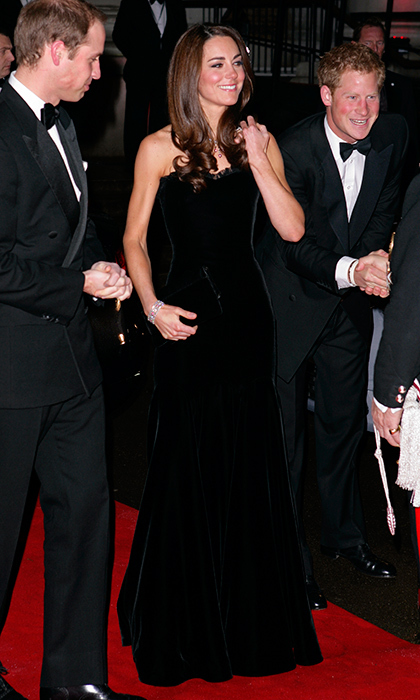 Joined by husband Prince William and brother-in-law Prince Harry, the Duchess of Cambridge was stunning in a sumptuous strapless black velvet Alexander McQueen gown at an awards ceremony at the Imperial War Museum in December 2011.