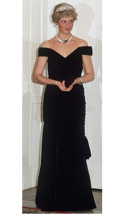Another iconic Diana look in velvet by Victor Edelstein, which the royal donned for a trip to Germany in 1987. The gown is known as 'The Travolta dress' because Diana also wore it when she famously took to the dance floor with the <I>Saturday Night Fever</I> star at a White House party in 1985.