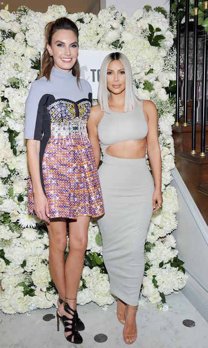 Kim Kardashian West and Elizabeth Chambers Hammer mingled at the The Tot holiday pop-up at The Grove's Santa Village in West Hollywood. The two ladies and guests began with champagne cocktails followed by a sit-down dinner that wrapped with the iconic Ladurée mini macarons for desert.