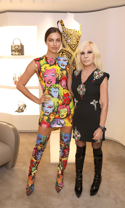 "Fashion history! Irina Shayk and Donetella Versace were posh during the opening of the Versace Boutique in London. After the event, the supermodel took to her Instagram to honor the fashion mogul saying, ""Bonding with this queen ❤️  @donatella_versace powerful strong iconic #donatellaversace always making me laugh  love you xx Iri ❤️ #staystrong."" 