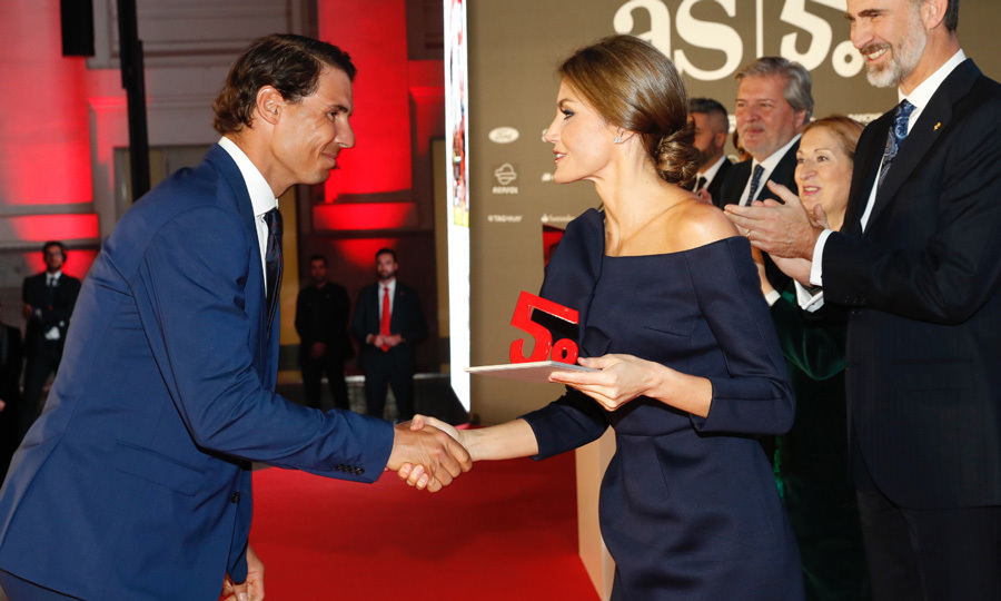 Queen Letizia served Spanish tennis player Rafael Nadal with an award at the 50th anniversary celebration of the Spanish sports newspaper AS. The Wimbledon champion beamed as he shook hands with Her Majesty as the royal presented him with the best Spanish Male athlete Award at the December 4, 2017 event in Madrid.