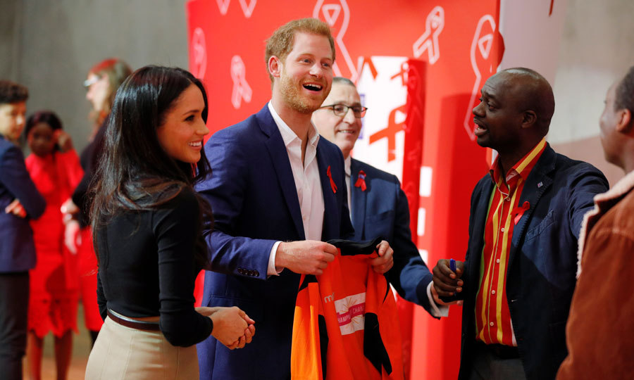 Harry laughed as he and his fiancée Meghan Markle were presented with a gift during their visit to the Nottingham Contemporary, which is where the Terrence Higgins Trust held the World AIDS Day fair. The pair were also shown a UK AIDS memorial quilt that was made by friends and lovers of those who passed from the disease. Harry is following in the footsteps of his mother, Princess Diana, in combating the stigma that surrounds the disease.