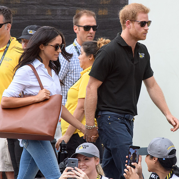 Meghan and Harry established early on that they weren't going to be shy about PDA. After more than a year of dating, the two made their first public outing as a couple at a wheelchair tennis match at the Invictus Games Toronto on September 25, 2017. The Prince and his American girlfriend arrived hand-in-hand and were pictured whispering and laughing together as they watched the sporting event together from the stands.