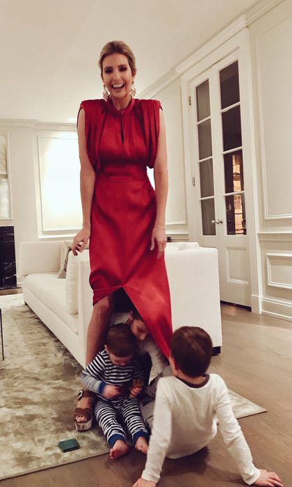 Peek-a-Boo, we see you! <i>The Women Who Work</i> author had some fun with her three children. Arabella, Joseph and Theodore played a game of peek-a-poo with their mom, hiding beneath her stunning red Prada gown in December 2017.