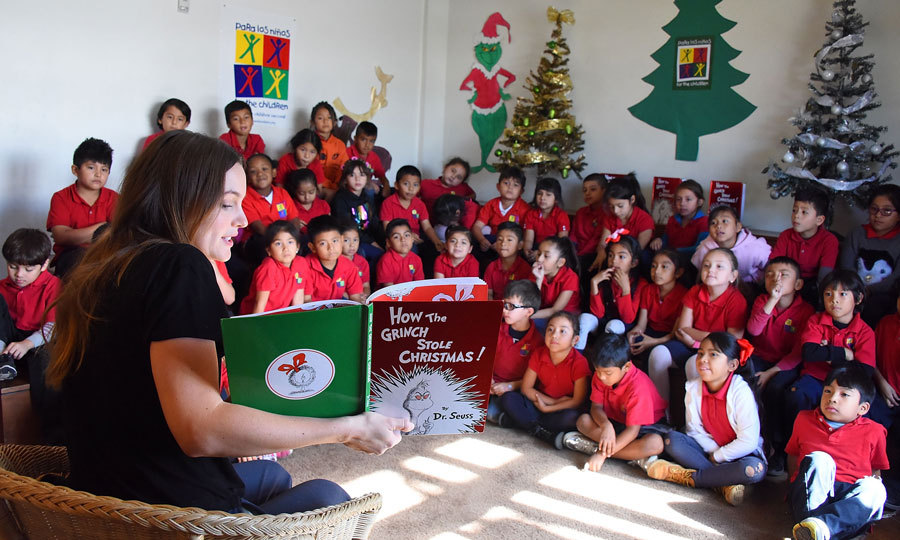 Leighton Meester got students at the Para Los Ninos school into the holiday spirit by reading them <i>How The Grinch Stole Christmas!</i> and serving lunch as a part of Random House's #GrowYourHeart campaign, a partner of Feeding America in L.A. on December 5.
