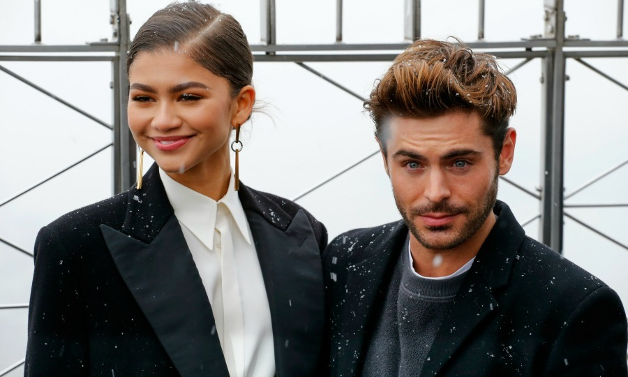 Let it snow! Zendaya and Zac Efron enjoyed a snowy Saturday afternoon at the top of the Empire State building in NYC on December 9. The actors braved the cold with their fellow <i>The Greatest Showman</i> co-stars, Hugh Jackman, Rebecca Ferguson, Keala Settle, and director Michael Gracey, to turn on the lights for the skyscraper's new music-to-light-show synced to the song <i>This Is Me</i> from their new film.
