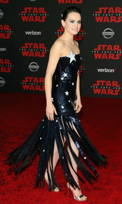 Oh my stars! Daisy Ridley sparkled in an out of this world dress for the premiere of Disney Pictures and Lucasfilm's <i>Star Wars: The Last Jedi</i> at The Shrine Auditorium, in L.A. on December 9. The actress showed off the frills on her ensemble as she twirled for the crowd while walking the glittery red carpet!