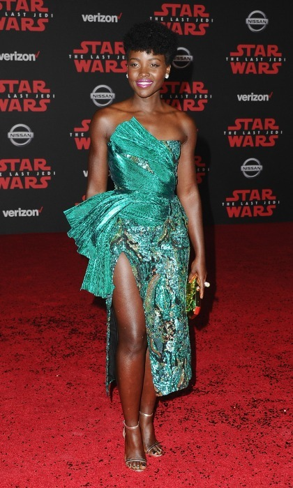 "Lupita Nyong'o turned heads on the blockbuster movie's L.A. red carpet. The 34-year-old actress wore a stunning emerald Halpern dress, opting to accessorize the mesmerizing look with Tiffany & Co. jewelry. Lupita took fans behind-the scenes of part of her carpet look on Instagram, writing: ""Red Carpet prep. Getting the foundation right is winning half the battle. I use @lancomeofficial Teint Idole Ultra 500 for the highlights, 550 for the lowlights and 560 to work with that inevitable Australian tan. Always best to have a few shades to change with your changes.""