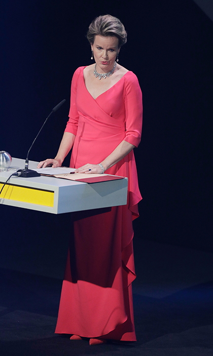 Queen Mathilde of Belgium donned a coral wrap dress and diamond jewelry for the German Sustainability Awards at the Maritim Hotel in Duesseldorf on December 8.