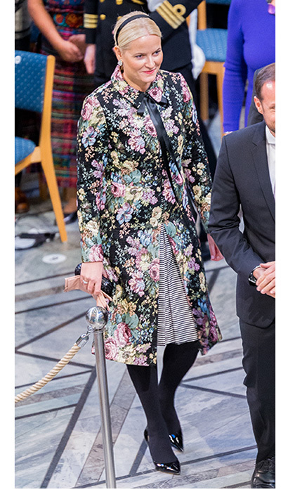Meanwhile, Crown Princess Mette-Marit of Norway wore a colorful floral coat and striped dress as she joined her husband Crown Prince Haakon for the Nobel Peace Prize ceremony at Oslo City Town Hall. The future queen accessorized with peach gloves, patent leather heels and a sweet hairband. 
