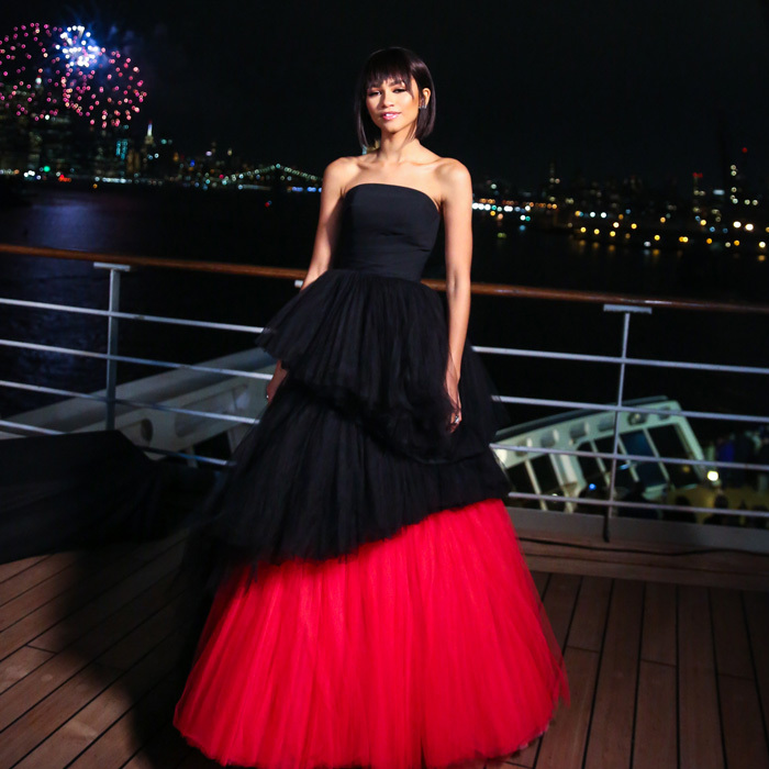 Baby, she's a firework! Zendaya wore a strapless Viktor & Rolf dress and Tiffany & Co. jewelry to <i>The Greatest Showman</i> premiere in NYC aboard the Queen Mary 2. She was joined by Hugh Jackman, Zac Efron and the rest of her co-stars at the Moët & Chandon-sponsored party.