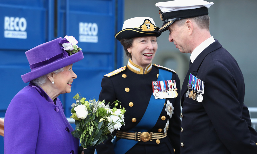 "Queen Elizabeth beamed alongside her daughter Princess Anne, who is the commodore-in-chief of HM Naval Base Portsmouth, while attending the commissioning ceremony of the HMS Queen Elizabeth at the HM Naval Base in Portsmouth, England. During the ceremony, the monarch gave a speech saying, ""As the daughter, wife & mother of naval officers, I recognize the unique demands our nation asks of you and I will always value my special link with HMS Queen Elizabeth, her ship's company and their families.""