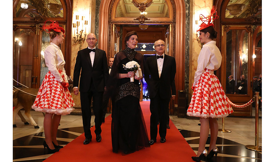 It's the surreal (royal) life! Princess Caroline of Hanover made an elegant entrance at the Surrealist Dinner Party, held at the Monte Carlo Casino on December 9. Behind the Monaco royal is Gaming Director Pascal Camia, left, and Monte-Carlo Société des Bains de Mer CEO Jean-Luc Biamonti.