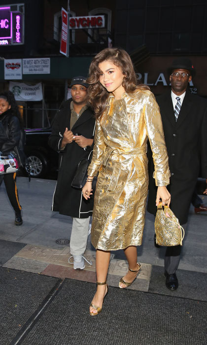 "Dripping in gold! Zendaya made an ""accidental reference"" to the Golden Globes when she stepped out in a Giuseppe di Morabito trench coat in NYC on December 11. The star's latest film <i>The Greatest Showman</i> is nominated in three categories, including Best Motion Picture – Musical or Comedy.