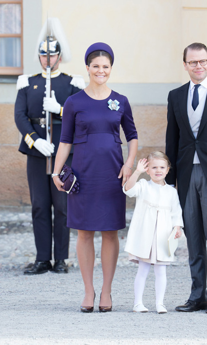 Joined by her daughter Princess Estelle while pregnant with second child Oscar, the Swedish Crown Princess wore a custom-made purple dress and matching pillbox hat for a family christening.