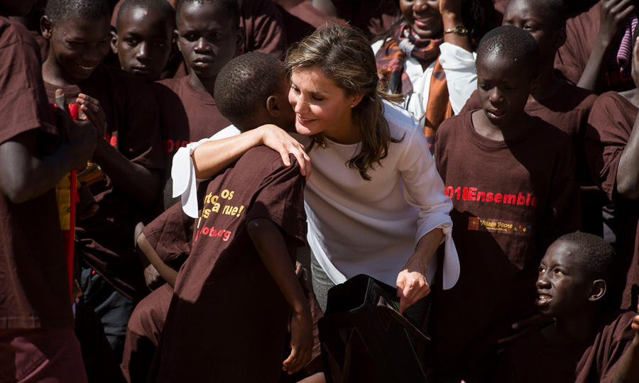 Kindness all around! Queen Letizia hugged a young man during her visit to the Village Pilote initiative for kids of the streets in Dakar, Senegal on December 14. The organization provides help for displaced children.