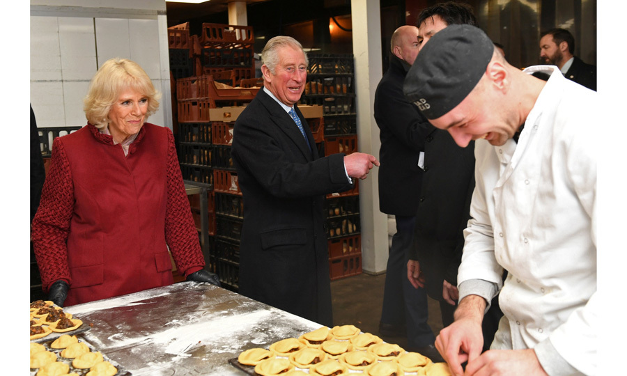 Sweet treats! Prince Charles and Camilla were all smiles as they spoke to a baker during their visit to Borough Market in London on December 13. During their trip, the royal pair met with stall-holders and members of the community.