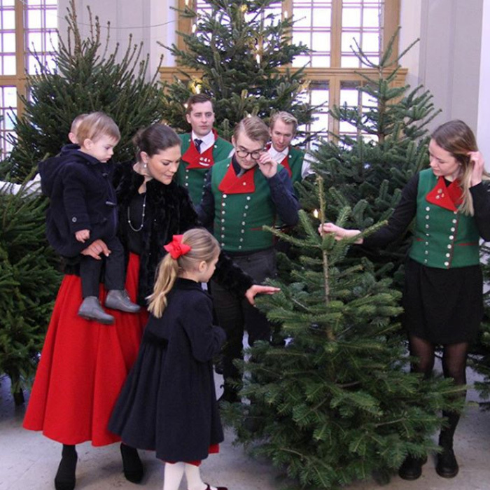 Crown Princess Victoria of Sweden had two special elves help welcome Stockholm Royal Palace's Christmas trees on Thursday, December 14. The future Queen was joined by her young children — Princess Estelle, five, and Prince Oscar, one.