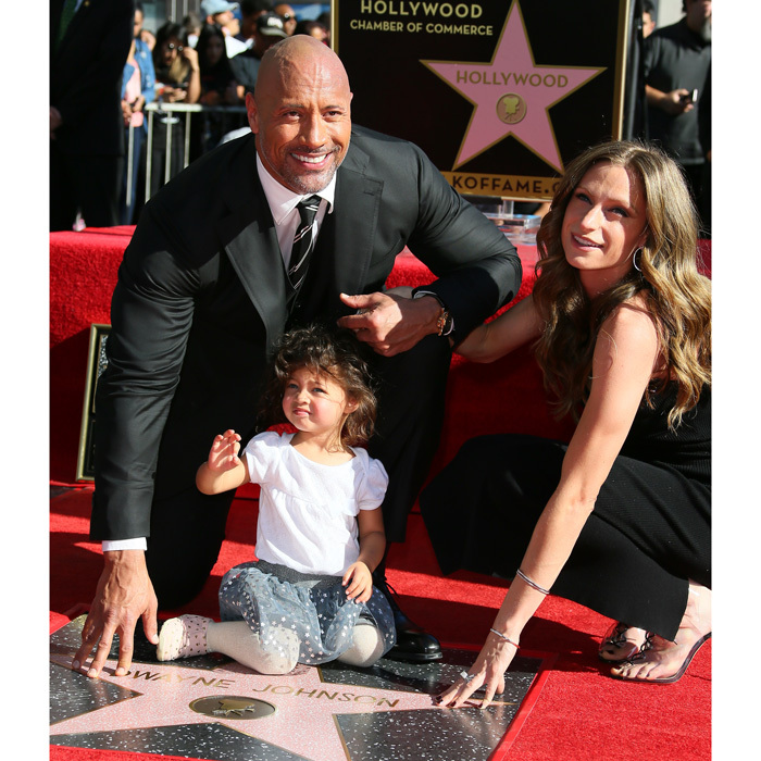 Dwayne 'The Rock' Johnson had a lot to smile about as he received his star on the Hollywood Walk of Fame on December 13. The <i>Jumanji: Welcome to the Jungle</i> star was joined by his pregnant girlfriend, Lauren Hashian and their daughter Jasmine.
