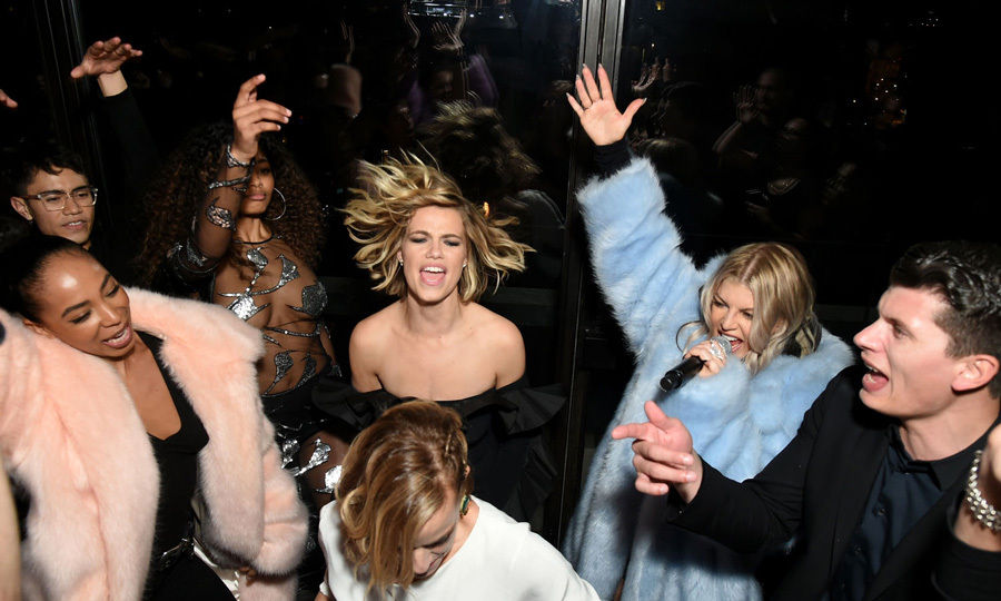 Hailey Clauson showed off her dance moves during Fergie's performance at a party celebrating the launch of CR Girls 2018 calendar in partnership with Technogym at Spring Place on December 12 in NYC.