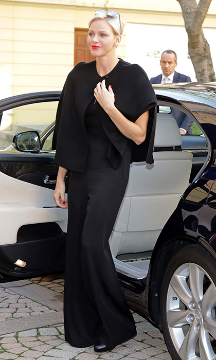 It's clear that one of the biggest fans of the classic cape is Princess Charlene. Here the royal wears a short black style and jumpsuit by Akris to a Christmas gift-giving event at the headquarters of the Red Cross in Monaco in November 2017. 