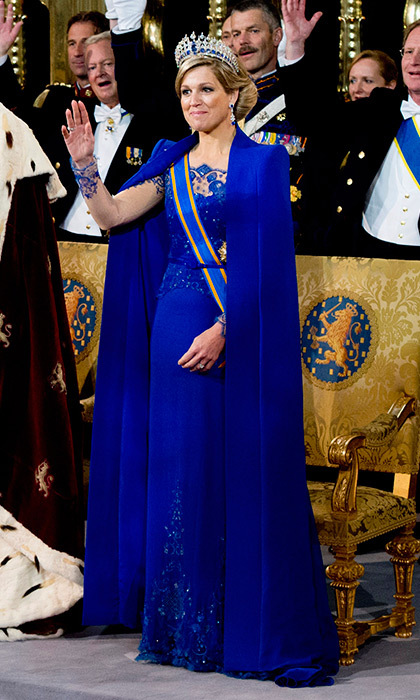 "For the day she became Queen, <a href=""https://us.hellomagazine.com/tags/1/queen-maxima/""><strong>Maxima of the Netherlands</strong></a> chose this regal Jan Taminiau creation in cobalt blue. The floor-length cape worn over an embroidered dress in the same hue was an instantly-iconic combination as husband Willem-Alexander ascended the throne.
