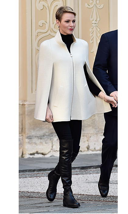 Here's another Princess Charlene winter look that is both practical and stylish! The Monegasque royal paired a white zip-front cape with flat thigh-high leather boots one year as she and husband Prince Albert II of Monaco handed out Christmas gifts at the Princely Palace in Monaco in 2015.  