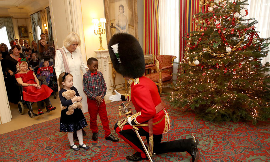 Clarence House had some special little helpers on hand to add the perfect finishing touches to Prince Charles and Camilla's Christmas tree! The 