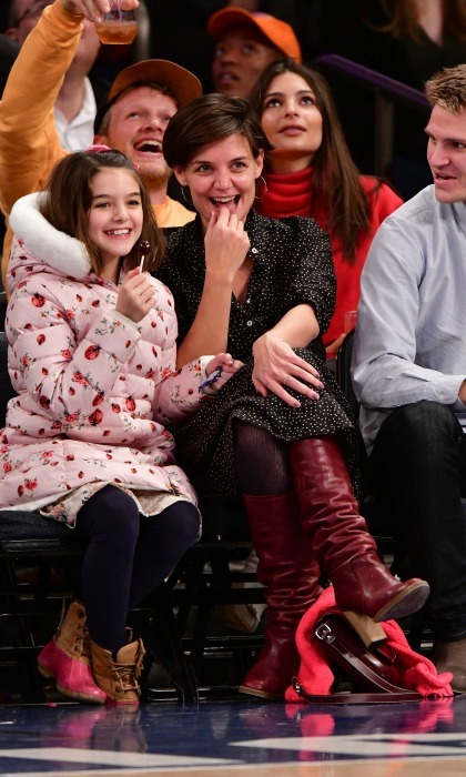 It was a star-studded family affair at the Oklahoma City Thunder vs. New York Knicks game at Madison Square Garden on December 16. Sitting courtside were the giddy mommy-daughter duo Katie Holmes and Suri Cruise. Some other family members joined the pair, including Katie's brother Martin Holmes Jr. (who can be seen poking his head into the photo on the right), and her parents: Kathleen and Martin Holmes Sr. The loved ones looked to be having a wonderful time, smiling as they enjoyed New York's win! Also spotted in the crowd was model Emily Ratajkowski, who can be seen sitting directly behind the group.