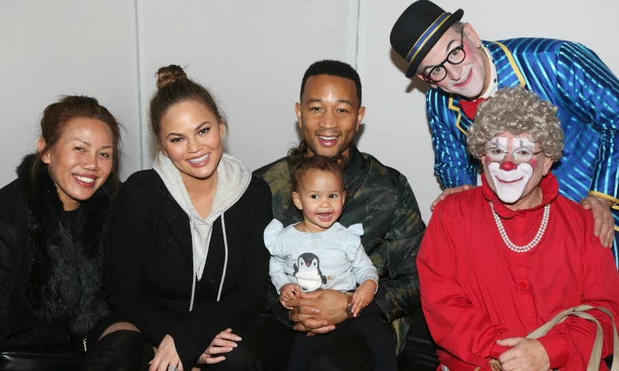 Chrissy Teigen and John Legend treated their adorable daughter Luna, 1, to see the Big Apple Circus on Saturday, December 16 at Lincoln Center in New York City. The couple, who are expecting their second child, were joined by Chrissy's mom Vilailuck (left) and some circus stars as they posed for photos backstage. 